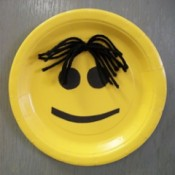 Smiley face paper plate.