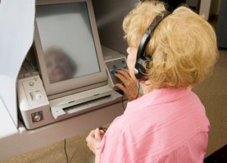 blind_woman using assistive technology to vote.
