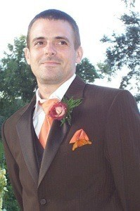 Groom with butterfly on his jacket