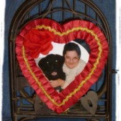 A picture frame made from a heart shaped candy box.