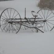 Snow covered farm rake.