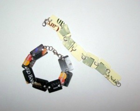 A bracelet made from parts of recycled gift cards.
