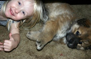 Child and puppy.