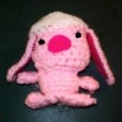 Pink crocheted amigurumi Easter bunny.