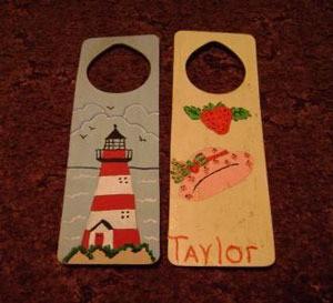 Two decorated door hangers.