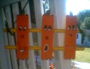 Ice cream stick pumpkins.