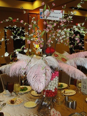 centerpiece with gumboils in vase filled with feathers and flowers