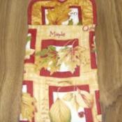 Potholder topped kitchen towel.