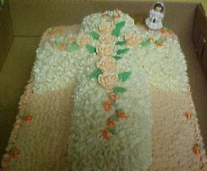 A cake shaped like a cross celebrating First Communion