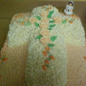 A cake shaped like a cross celebrating First Communion
