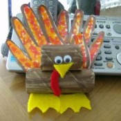 A paper turkey craft made from a child's handprints.