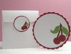Round card and tag with cherry motif.