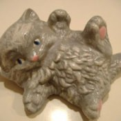 A ceramic kitty that has been painted.
