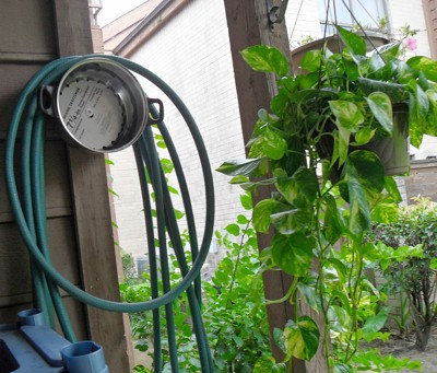 cooking pot as hose hanger