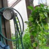 cooking pot as hose hanger