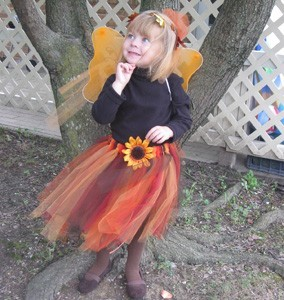 little girl wearing the costume