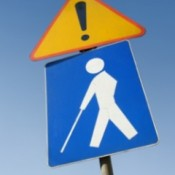 caution sign, blind person walking with a cane