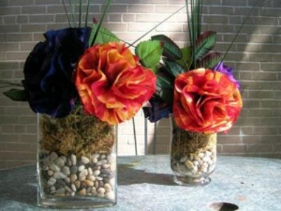 Coffee filter flowers in stone filled vases