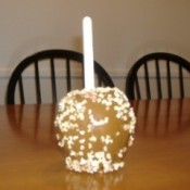 Closeup of faux caramel apple.