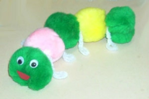 White, green, and yellow pom pom caterpillar.