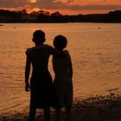 2 boys at sunset