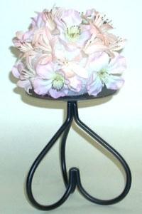 Styrofoam ball covered in flowers.