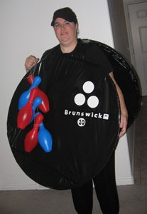 Woman dressed as a bowling ball.
