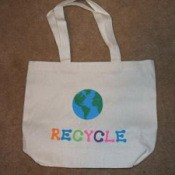 """Plain tote bag decorated with earth and """"recycle""""."""