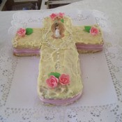 A cake shaped like a cross to celebrate First Communion.
