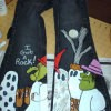A pair of jeans painted with a Halloween scene from Charlie Brown.