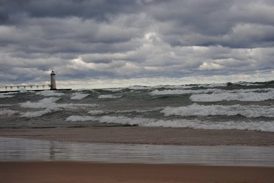 Storm  clouds and waves on lake.