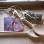 Spoons on wooden tray.