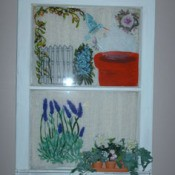 Decorated and painted old window wall hanging.