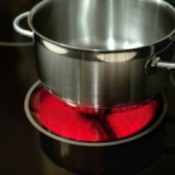 A pot on a ceramic stovetop.