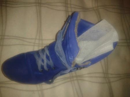 Dryer sheet in sneaker.