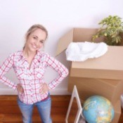 Woman Moving With Houseplants