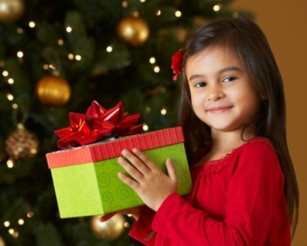 a young girl holding a gift