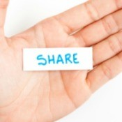 "A hand with a  note that says ""share""."