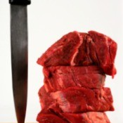 A stack of raw beef tenderloin.