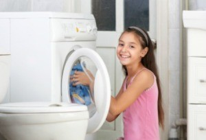 girl cleaning laundry