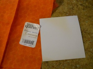 Fabric and cardboard square.