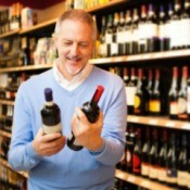 man buying wine