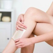 Woman Hot Waxing (Depilating) Her Legs