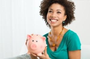 A woman holding a piggy bank.