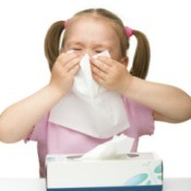 Little Girl using Kleenex Facial Tissues