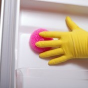 Cleaning the inside of a refrigerator.