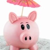A pink piggy bank on the beach.