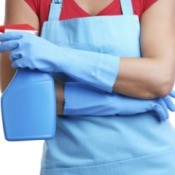 A woman wearing cleaning gloves.