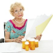A woman looking at Medicare paperwork.
