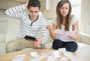 A girlfriend and boyfriend struggling to pay bills.